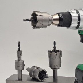 Hole drill with carbide inserts for hand drills and stationary drills